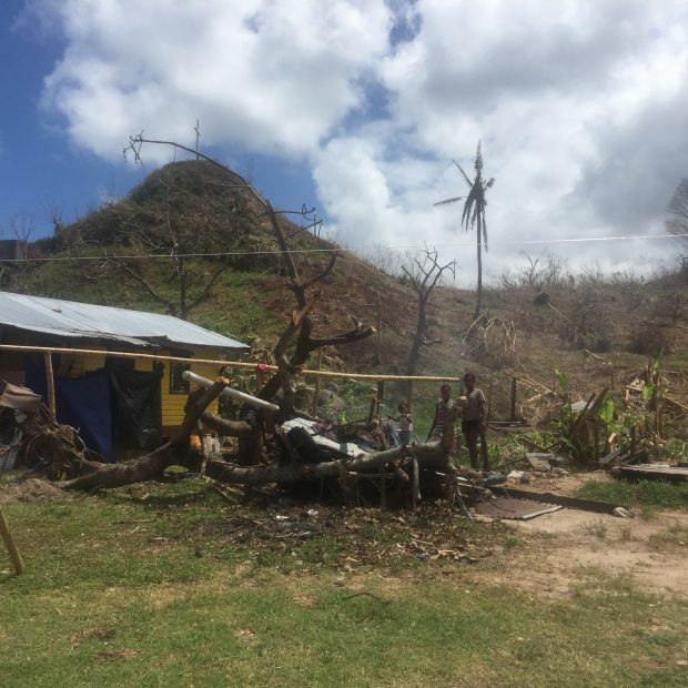 Family outside home in Lavena, Taveuni Island